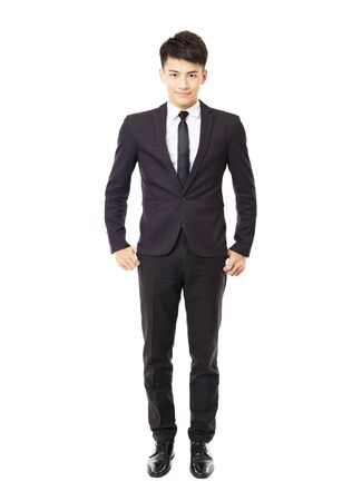 standing businessman: happy young businessman isolated on white