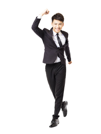 young business man running and isolated on white Stock Photo