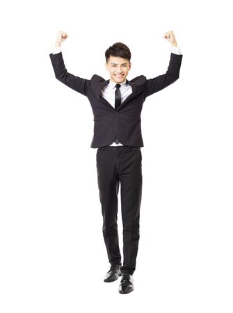 successful man: happy  young business man with successful gesture