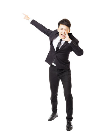 happy workers: young business man shouting and isolated on white