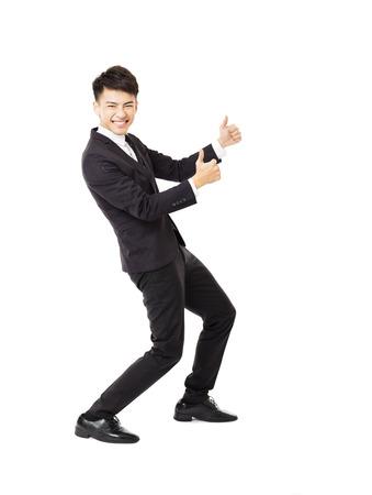 uomo felice: Felice giovane uomo d'affari con gesto di successo Archivio Fotografico