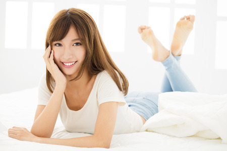 smiling Beautiful young woman  in bedroom
