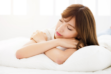 asian woman face: Beautiful young woman sleeping in bedroom