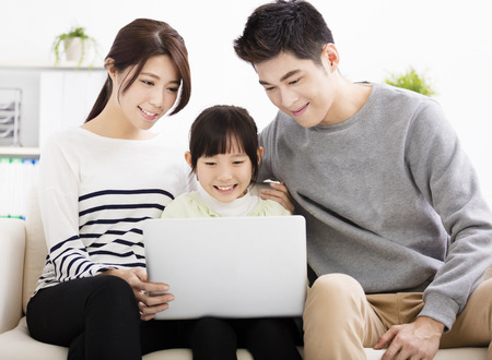 Happy Attractive Young  Family watching the laptop