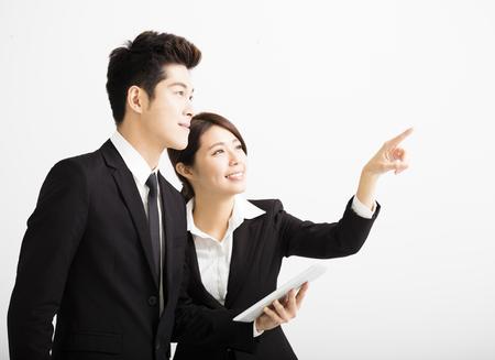 Boldog üzletember kollégáival keres Stock fotó