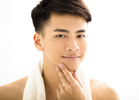 beautiful boy: Closeup portrait of attractive young man face Stock Photo