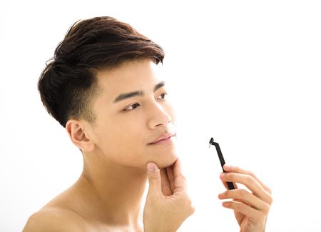 Primo piano ritratto di giovane uomo faccia