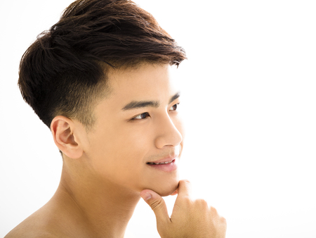 young boy smiling: Closeup portrait of attractive young man face Stock Photo