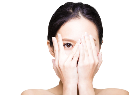 covering: young woman covering her eyes by hands Stock Photo