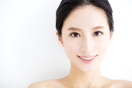 asian style: closeup beautiful young smiling  woman  face Stock Photo
