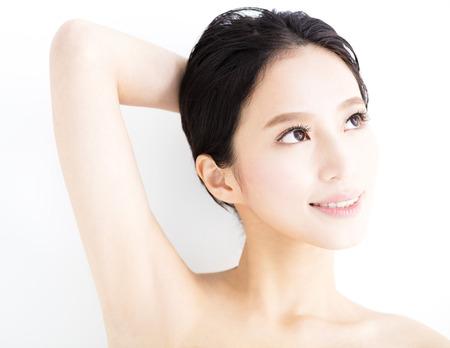 armpit: closeup beautiful young smiling  woman  face Stock Photo