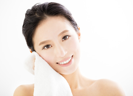 towel: young woman cleaning her face with  towel Stock Photo