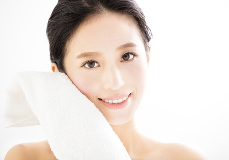 woman in towel: young woman cleaning her face with  towel Stock Photo