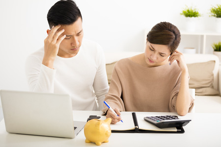 stressed business woman: husband and wife with financial stress