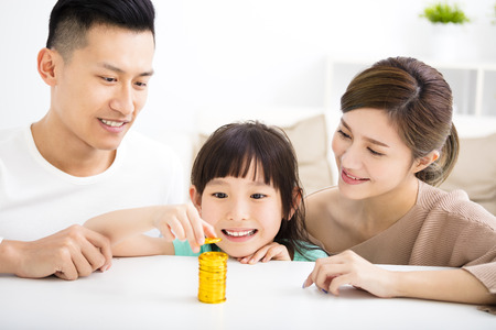 happy family money saving concept Stock Photo