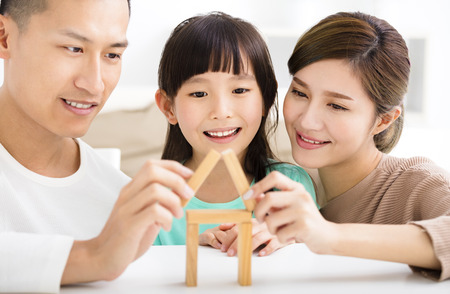 asian girl face: happy family playing with toy blocks Stock Photo