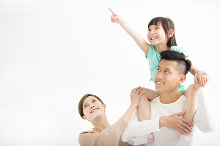 Happy family looking away and pointing 스톡 콘텐츠