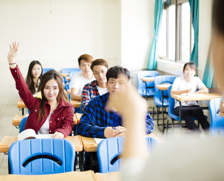 male hand: Teacher with  group of college students in classroom