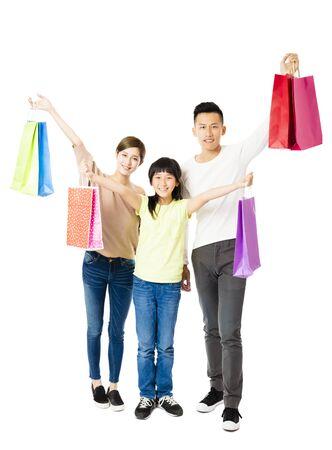Glückliche attraktive junge Familie mit Einkaufstüten Standard-Bild