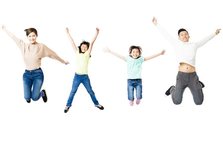 happy family jumping together isolated on white