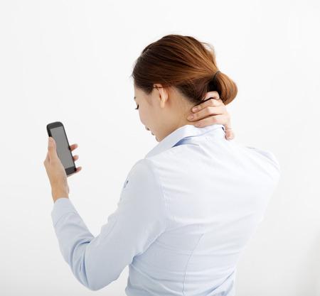 Business vrouw met schouder- en nekpijn Stockfoto