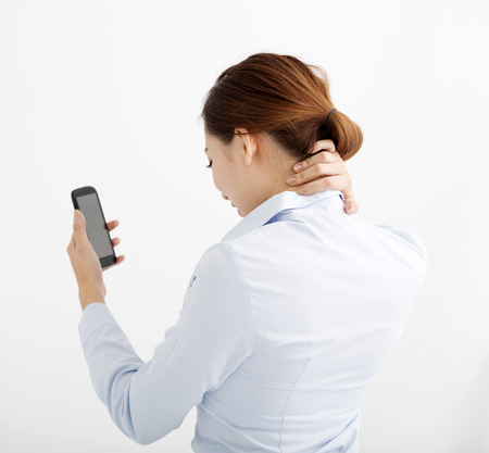 hand pain: business Woman with shoulder and neck pain Stock Photo