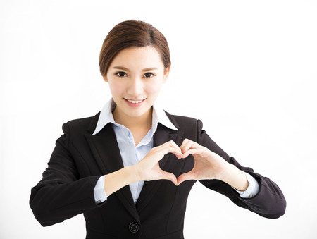 heart in hand: Young smiling business woman making heart shape Stock Photo