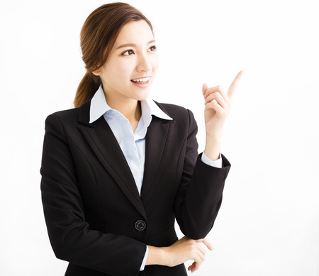 white suit: Beautiful young business woman pointing and looking