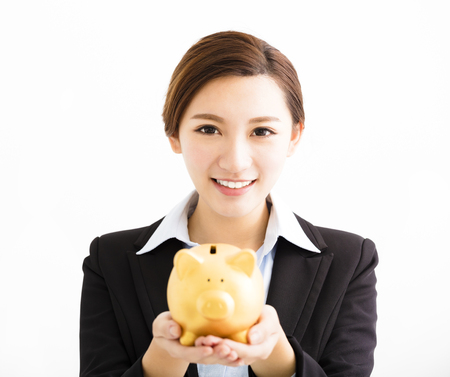 money concept: smiling business Woman showing the  piggy bank Stock Photo
