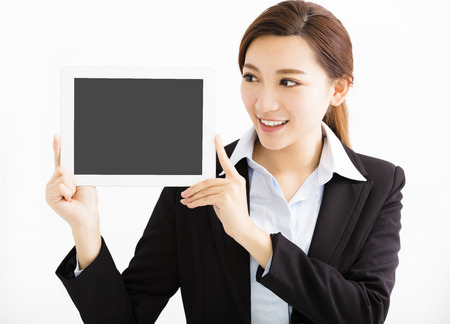 hand pointing: happy Business Woman Showing the tablet