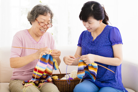 knitting: happy Senior mother and  daughter  learning knitting Stock Photo