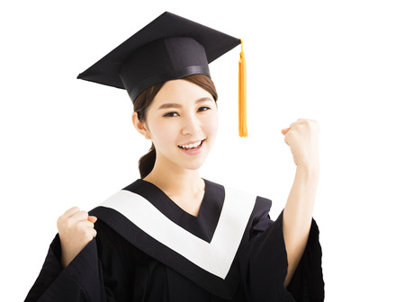 graduating: happy graduating student raise hand with success gesture