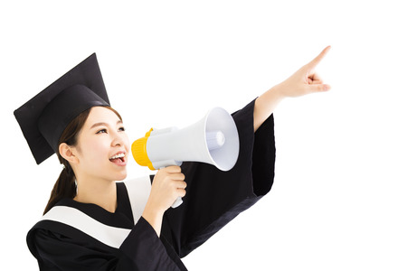 academic robe: young female Graduation Shouting With Megaphone Stock Photo