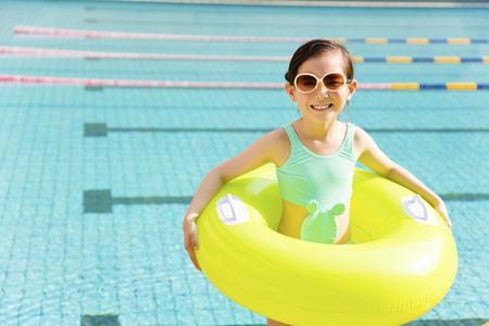 asia children: happy little girl having fun  in swimming pool