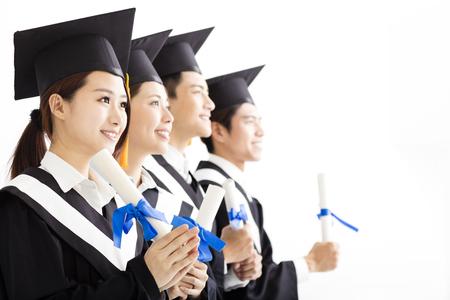 onderwijs: Gelukkig groep van afstuderen op zoek naar de Toekomst Stockfoto