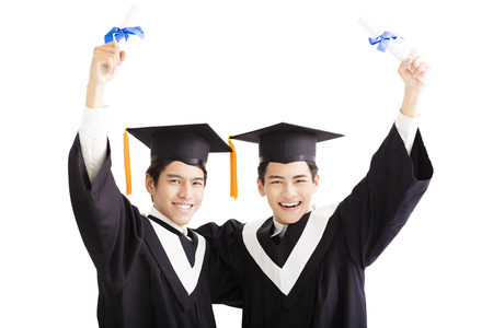 graduating: Two happy graduating students isolated on white