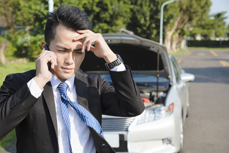 worried businessman: stress business man calling for help with  car broken concept