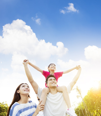 lifestyle outdoors: happy asian family with cloud background Stock Photo