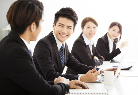 group of business people having meeting together