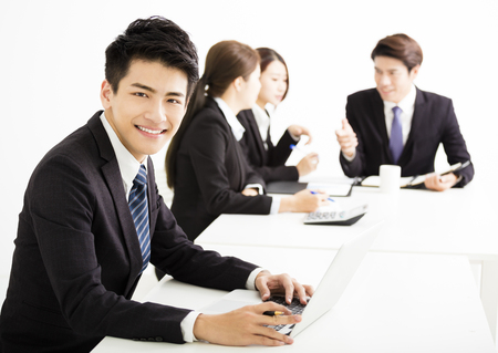 young executive: businessman with business people having meeting together