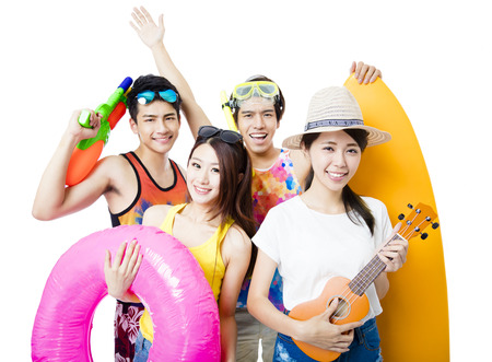 asian lifestyle: happy young Group  holding beach accessories Stock Photo
