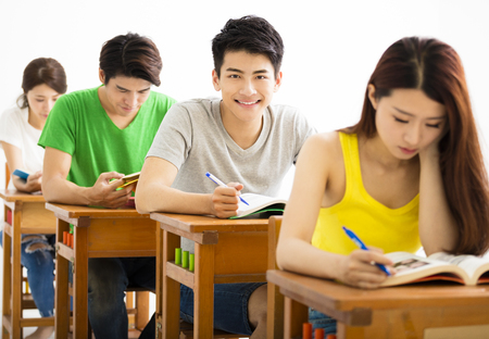 young college student group sitting in a classroom