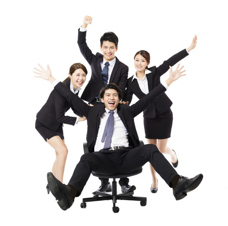 cheer full: happy Business  group  push colleague sitting in chair