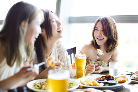 happy young group enjoying dinner party Stock Photo
