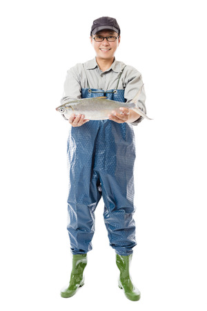 the big fish: happy fisherman showing big fish isolated on white Stock Photo