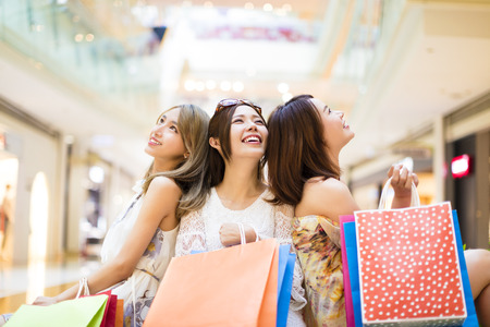happy shopper: relaxed young woman holding shopping bags in the mall Stock Photo