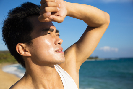 heat wave: young man under hot summer heat wave