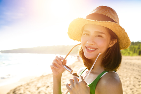 warm water: beautiful young woman enjoy summer vacation on the beach Stock Photo