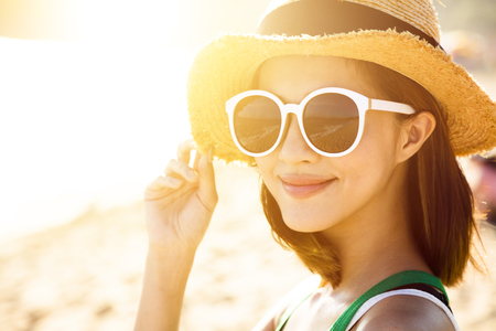 woman in water: beautiful young woman enjoy summer vacation on the beach Stock Photo
