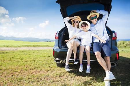 road travel: happy family enjoying road trip and summer vacation Stock Photo